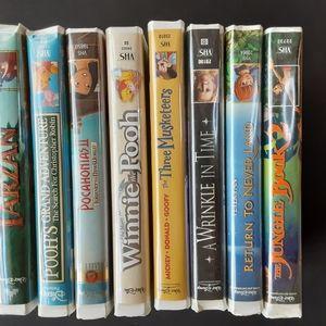set of 8 vintage VHS tapes